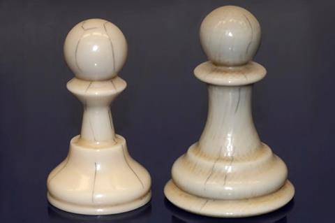 An image showing 3D printed pawns with scalpel lines inked