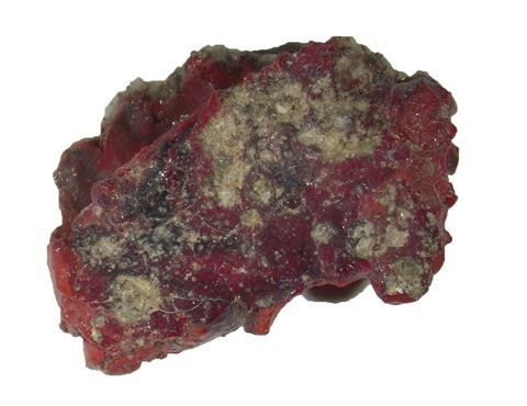 A photo showing a piece of red and brown rock
