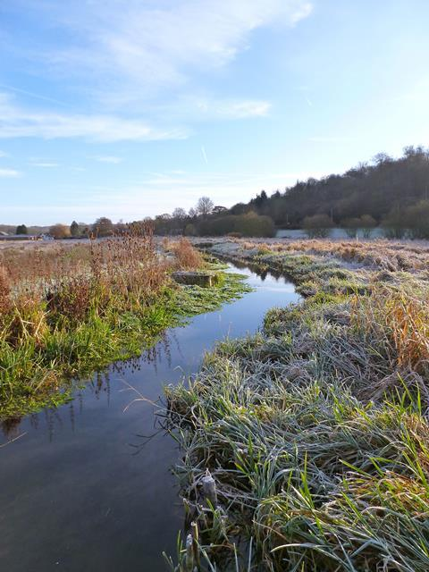 A photo of a river in a frosty landscape