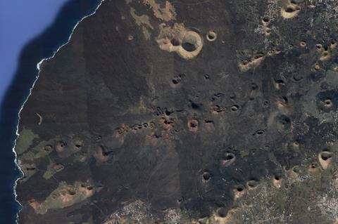 An image showing cinder cone volcanoes in Lanzarote