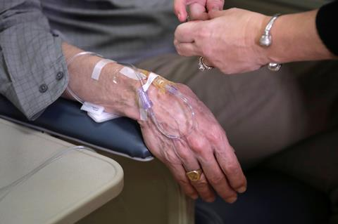 An image showing a patient's hand during a clinical trial of aducanumab