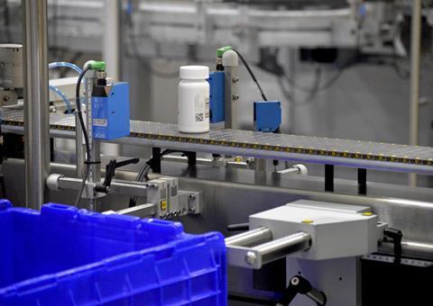 Drug bottle on conveyor belt